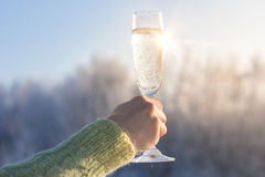 Glass of champagne in hand. Royalty Free Stock Photography