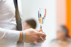 Glass of champagne in hand Royalty Free Stock Photo