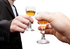 Glass of champagne in his hand Royalty Free Stock Photos