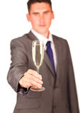 Glass of champagne hold by a businessman Stock Photo