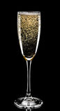 Glass of champagne isolated on black background Royalty Free Stock Photography