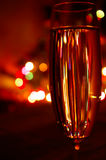 A glass of champagne on lights background. A glass of champagne and abstract lights bokeh background stock photos