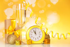 Glass of champagne next to the clock and Christmas Royalty Free Stock Photography