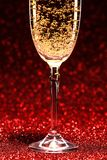 Glass of champagne ready for christmas celebration Royalty Free Stock Photos