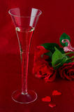 A glass of champagne and red roses  for Valentine's Day Royalty Free Stock Photo