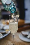 A glass of champagne. In a restaurant Royalty Free Stock Photography