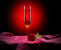 Glass of champagne and rose on black Royalty Free Stock Photos