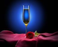 Glass of champagne and rose on black Stock Photo