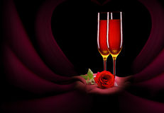 Glass of champagne and rose on black Stock Photography