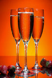 Glass of champagne with strawberry Stock Images