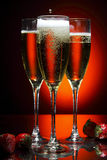 Glass of champagne with strawberry Stock Photography