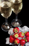 Glass of champagne with strawberry Royalty Free Stock Images