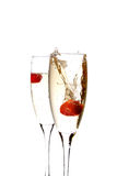 Glass of champagne with strawberry inside Royalty Free Stock Images