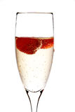 Glass of champagne with strawberry inside Stock Photography