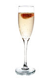 Glass of champagne with strawberry inside Stock Photos