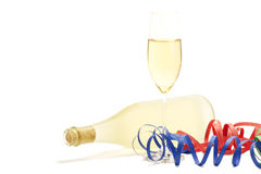 Glass with champagne with streamer in front of a p Stock Photo