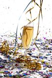 Glass of champagne with streamers and confetti Stock Photo