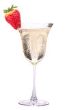 Glass of champagne with tasty strawberry Royalty Free Stock Images