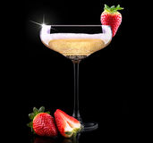 Glass of champagne with tasty strawberry Royalty Free Stock Photography