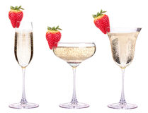 Glass of champagne with tasty strawberry Stock Photos