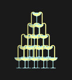 Glass of champagne tower. Alcohol in glass belfry. Wine pyramid. Stock Image