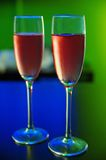 Glass of champagne. Two glasses of champagne on blue and green background Royalty Free Stock Photography