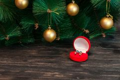 A glass of champagne under the Christmas tree on a dark background stock photo