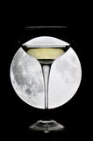 Glass of champagne under a full moon Royalty Free Stock Images