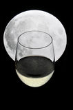 Glass of champagne under a full moon Royalty Free Stock Photography