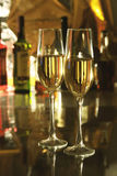Glass of champagne or white wine on mirror table. bottles in a bar on the background. Celebrities composition. selective. Focus Royalty Free Stock Photography