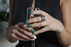 Glass of champagne in womans hands Royalty Free Stock Photos