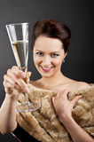 Glass of champanage holding by woman Royalty Free Stock Photos