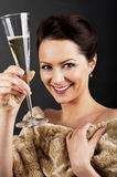 Glass of champanage holding by woman Stock Image