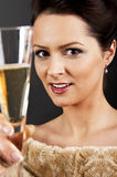 Glass of champanage holding by woman Royalty Free Stock Photography