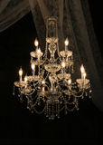 Glass Chandelier. Against a dark background Royalty Free Stock Images