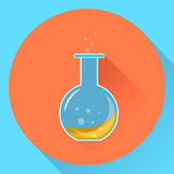 Glass chemical flask with a liquid  substance inside. Stock Photo