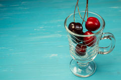 Glass with cherries Stock Image