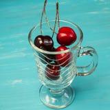 Glass with cherries Stock Photo
