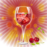 Glass of Cherry juice with Cherry and coloured Royalty Free Stock Photography