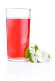 Glass of cherry juice and flowers  Stock Photography