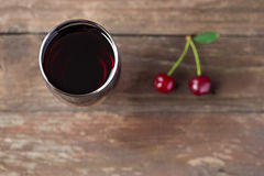 Glass of cherry juice Royalty Free Stock Image