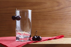 Glass and cherry Stock Photography