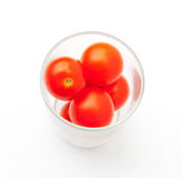 A glass of cherry tomatoes Stock Images