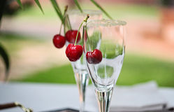 Glass with cherry Stock Images