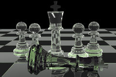Glass Chess. Battle on board Royalty Free Stock Photo