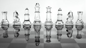 Glass chess. On the chess board Royalty Free Stock Photo