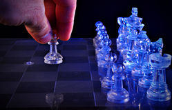 Glass chess. Translucent blue glass chess figures on a board Royalty Free Stock Image