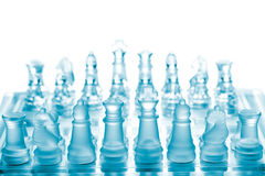 Glass chess. Set on chessboard Stock Images