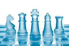 Glass chess. Set on chess board Stock Images