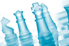 Glass chess. Set on chess board Stock Photo